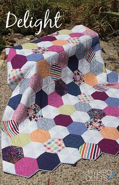 Delight Quilt! | jaybird quilts | Bloglovin'--If you have been saving or eyeing up some luscious large scale prints, you're going to love how those prints are featured on the large hexagons in this quilt! This is another fun quilt for all of my Hex N More ruler fans.