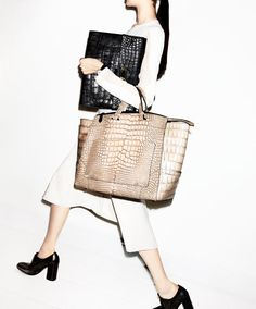 The Bag: Reed Krakoff Alligator Bags, 877-733-3525.    The Look: Dress, $1,990, bags and shoes, $750, Reed Krakoff, 877-733-3525. Longines watch, $1,000, longines.com.