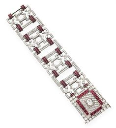 A DIAMOND AND RUBY BRACELET, BY HENNELL
