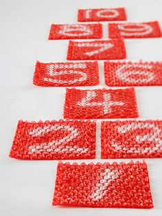 """Hop, Skip, Bang    Set up a Bubble Wrap hopscotch course in the garage. It's loud, legal, and safe. Apply doublesided adhesive tape to the underside of the painted squares to prevent them from slipping."""