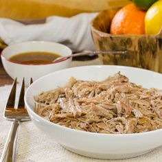 Slow-Cooker Cuban Pork. So healthy. Lots of fresh juices keep this pork recipe moot and tender! #crockpot