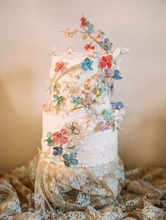 This whimsical bridal shoot is whisking us away to a land far, far away, but near to our hearts. With colorful floral flourishing all around, these gorgeous gowns from Claire Pettibone look like they've stepped out of our favorite storybook. Wedding Cakes With Flowers, Cake Wedding, Cake Flowers, Gown Wedding, Wedding Blog, Wedding Dresses, Flower Cakes, Wedding Ideas, Claire Pettibone Wedding Gowns