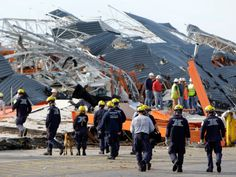 Members of Missouri Task Force One search-and-rescue team work at a tornado-damaged Home Depot store Tuesday, May 24, 2011, in Joplin, Mo.