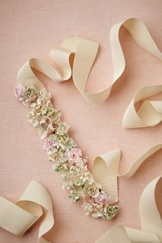"Floral sash. 100""L, 1.5""W ribbon; 9""L, 2""W embellishment. Rayon grosgrain, silk flowers."