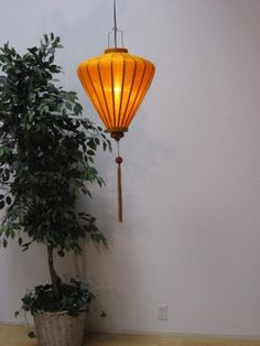 """SILK AND BAMBOO CHINESE LANTERN 33"""" - GOLD. Lantern measurements:  33""""H from top of metal frame to bottom of the tassel. Lantern only (not including metal frame or tassel) - 17""""H X 14""""W for our diamond lantern. Silk lantern comes complete with 12' lighting cord and usage instructions. For this lantern, we recommend using a clear glass bulb between 25 and 60 watts. DIAMOND. $43"""