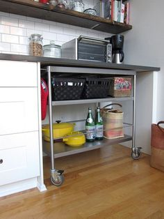 If you had enough space, it would be cool to have a rolling cart that pulled out for an extra countertop when needed.