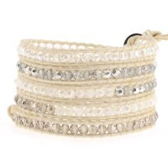 "Victoria Emerson 5-Wrap Bracelet. Ivory Leather with a mix of clear, white opal, silver dorado, and smoked crystals. Each bracelet has one clasp with closures at 34"", 35"" and 36""."
