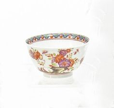 Tea Bowl with Indian Flowers.   Meissen. Circa 1740.     Porcelain, enriched in colours. Height 4,5cm.   Crossed swords marking, dreher's mark.