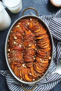 This maple harissa sweet potato gratin elevates traditional sweet potato casserole with a a bit of heat and nutty almond dukkah topping! Sweet Potato Casserole, Sweet Potato Recipes, Healthy Side Dishes, Side Dish Recipes, Vegetarian Recipes, Cooking Recipes, Healthy Recipes, Diner Recipes, Plats Healthy