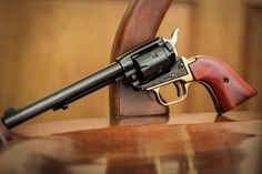 Heritage Rough Rider. Great single action revolver.  Love this cowboy gun. Custom with brass bottom.  Single action shooting gun.