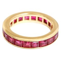 Beautiful Ruby Gold Eternity Band Ring | From a unique collection of vintage band rings at https://www.1stdibs.com/jewelry/rings/band-rings/