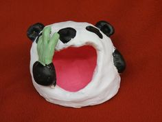 Big Mouth Pinch Pot Creatures. This adorable panda was made by a 7th grade student.