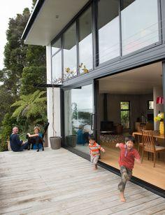 A serene west-Auckland home with calming sea views - Old Garage, Inside Home, New Deck, Run Around, Glass Texture, Open Plan Kitchen, Blue Walls, Stunning View, Auckland