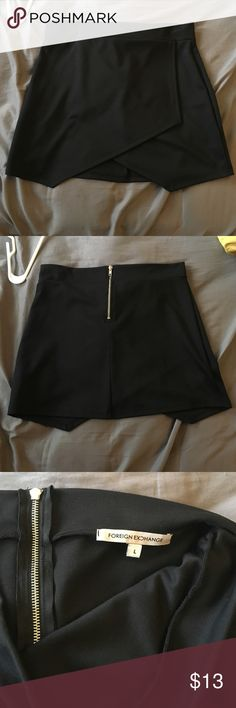 Foreign Exchange skirt Black skirt. Stretchy but thick. Zipper on back. Interesting cris cross design on front. Size large. Never worn. Foreign Exchange Skirts Mini
