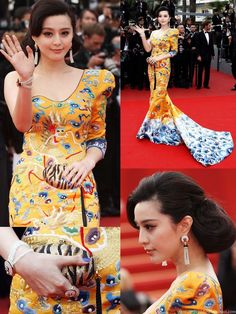 Cannes Film Festival 2010 Chinese actress Fan Bing Bing (范冰冰) yellow embroidered long pao-inspired one-shoulder gown featuring oriental motifs at the 'Robin Hood' Premiere  2010. Designed by Chinese fashion designer Laurence Hsu (劳伦斯·许), the dress called dong fang xiang yun (东方祥云 or literally Eastern Oriental Auspicious Cloud) took 30 workers 11 days straight to complete the hand embroidery and finishing.