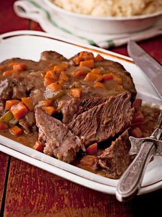 This pot roast slow-cooks until the meat turns brown and tender and the flavor mellows to an almost caramel overtone. Browned bits in the pan become the base for the rich red-wine gravy. Slow Cooker Recipes, Crockpot Recipes, Red Wine Gravy, Chicken And Wild Rice, Cheesy Potatoes, Corn Chowder, Toasted Pecans, Roasted Vegetables, Buttercup