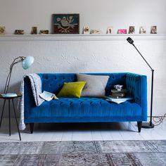 Modern living room with blue velvet sofa and task lighting | Living room decorating | Homes & Gardens | Housetohome.co.uk