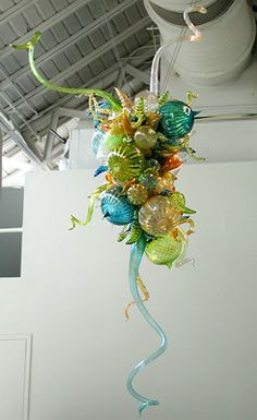 """DALE CHIHULY  TEAL, CITRON, AND AMBER CHANDELIER, 2002  10'6"""" X 6'8"""" X 6'  ON DISPLAY OCTOBER 12, 2002 THRU APRIL 6, 2003  GROUNDS FOR SCULPTURE  HAMILTON, NEW JERSEY"""