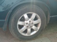 Tire rotation on a Honda CRV. johnyblogscars