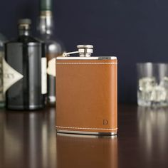 Leather Flask, Mocha | Clad in brown leather and featuring an attached, rubber-sealed cap, this flask has efficiency and good looks.