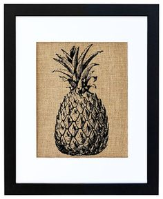 This vintage-looking pineapple print would look charming in the kitchen or in any room that favors botanical or tropical themed decor. Hand-printed onto burlap for a natural touch and then neatly framed in a contemporary black frame and white matte, it will fit in with any color scheme you've got going and look equally comfortable in rustic or modern settings.