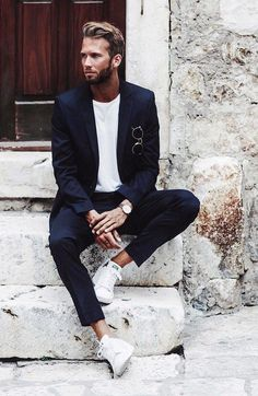 Yes, it is a trend to pair up suits with sneakers, and believe me this style creates magic.