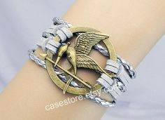 Mockingjay pin braceletShine grey leather by charmcover on Etsy, $7.99