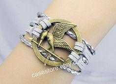 Mockingjay pin braceletShine grey leather by charmcover on Etsy, $7.99