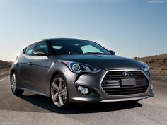 The 2013 Hyundai Veloster Turbo...never thought I would trade up my BMW for a Hyundai, but this car made me change my mind. The 40 MPG fuel economy doesn't hurt either!