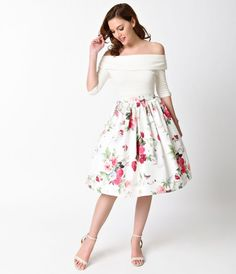 A florists dream of blooming splendor, dames! Freshly cut from Unique Vintage, this graceful 1950s inspired skirt is crafted in a woven satin like blend for a luxurious smooth touch. A gorgeous print of posies and green leaves dance on a bright ivory back
