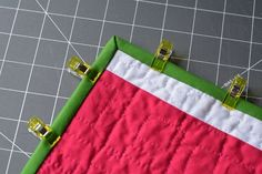 What's the secret to sewing sharp, neat mitered corners on your quilt binding? Find out with this tutorial, including a few expert tips.