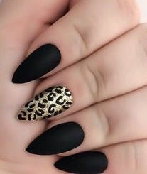 Black almond nails with an accent gold leopard