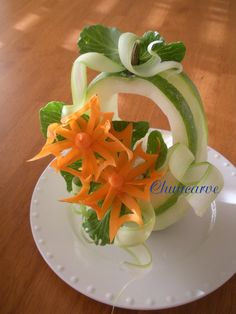 This beautiful cut out pinwheel flowers are carve from carrot place on top of squash basket and garnish with celery ribbons.