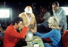 "Elvis on the movie set for the 1968 movie ""Speedway"" with costar, Nancy Sinatra as his romantic interest. Elvis was paid $850,000 plus 50% of the profits.  Filming began on 26 June 1967."