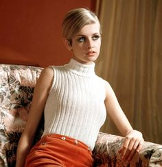 twiggy - love the winter white sleeveless knit turtleneck