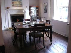 """The dining parlour at Chawton Cottage, Jane Austen's House Museum. """"The dining parlor has on display part of the dinner service that belonged to Jane's brother Edward Austen Knight. Cassandra managed most of the meals served at Chawton Cottage, but Jane prepared breakfast over the small range-like grate in the hearth, and spent her mornings writing in this room."""" - Syrie James. http://austenauthors.net/jane-austens-house-museum-my-visit-in-pictures"""