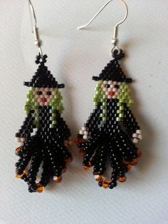Seed bead and swarovski crystals sliver plated surgical steel earring hooks. Very cute for Halloween