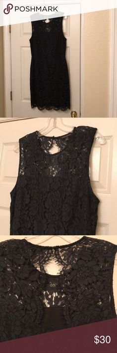 Banana Republic lace floral dress This Beautiful dress is has a black lining with and very dark blue lace floral overlay. It has scalloped edges along the bottom and along a back keyhole detail. Zipper is in perfect condition. There is a button elastic close at the very top near the neck. This dress was worn once and in perfect condition after being dry cleaned. Lining is black and made of a stretch material. Made of cotton and polyester, can be machine washed and tumble dried. Banana…