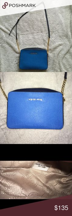 "Michael Kors Jet Set crossbody bag Blue/Navy Like new! Only used a handful of times. Beautiful 100% Authentic Michael Kors crossbody. No stains or rips.  Approx Dimensions: 9"" (L) x 6"" (H) x 2"" (W)  Adjustable Chain Crossbody Strap with Approx 22"" - 25"" Drop  Color: Blue / Navy  Material: Saffiano Leather  Product Details:  Zip Top Closure with Hardware Pull Michael Kors Logo at Front Gold Tone Hardware Inside Two Slip Pockets Fully Fabric Lining Michael Kors Bags Crossbody Bags"
