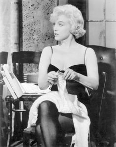 "Marilyn Monroe knitting ""I don't mind living in a man's world as long as I can be a woman in it."""