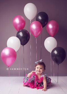 Tape balloons to the floor for photo shoot - love this idea for a first birthday!