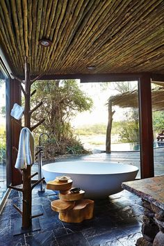 Singita Boulders Lodge is nestled in a acre wildlife refuge in the middle of Sabi Sands Game Reserve near Kruger National Park in South Africa. Indoor Outdoor Bathroom, Outdoor Baths, Outdoor Spa, Outdoor Living, Boulder Lodge, Sand Game, Game Reserve, Interior Exterior, Tulum
