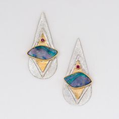 Boulder opal earrings with blues, pinks, and greens. The layered 22k gold bi-metal with fine silver, creates a modern art look.