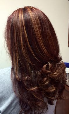 Multi dimensional hair color. Red base with caramel highlights, and dark mocha lowlights. Beautiful, long, curled hair. Tabitha Richardson The ChopShop Somerset, Kentucky