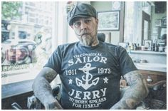 sailor-jerry-long-john-blog-schorem-barbiers-barber-rotterdam-shaving-authentic-shop-store-holland-sailors-tattoo-usa-old-school-vintage-shirt-tshirts-john-spoel-agent-agency-photography-1.jpg (800×531)