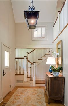 Interior Design Ideas: Staircase, light, railing and a window wall make a lovely entry.  Designed by Jarrett Vaughan Builders, Inc.