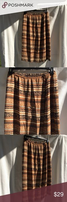 Rena Rowan petite printed long maxi skirt 12P Rena Rowan petite printed long maxi brown tan skirt. Size 12P. Shell is 100% Rayon. Lining is 100% acetate. Pre-loved in excellent condition. Women's Ladies Fashion. Check out my closet, we have a variety of women's, Victoria Secret, handbags 👜 purse 👛 Aerosoles, shoes 👠fashion jewelry, necklace, clothing, dress, Beauty, home 🏡 .  Ships via USPS. Smoke & Pet-Free. Offers 30% OFF bundle discount. Always a FREE GIFT 🎁 with every purchase…