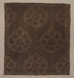 Date: 13th–14th century Century: 13th Century AD Media: Silk, Silver; Lampas Dimensions: 61.4 x 61.4 cm (24 3/16 x 24 3/16 in.) Department:Costume and Textile Arts Object Type: Fragment Country: Turkey Continent: Asia Culture/People: Seljuk Period Accession Number: 1999.182.11 Pattern of endless knot design with a pointed upper loop. Gold metallic weft on dark gray ground. Mounted on tan background on rigid frame.