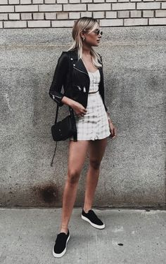 Pinstripe white and tan two piece romper with a leather jacket. Style and fashion for women