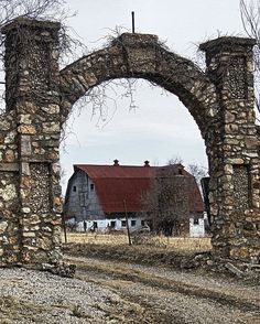 Old barn framed by a stone entry, located along old route 66 near Bourbon, MO.